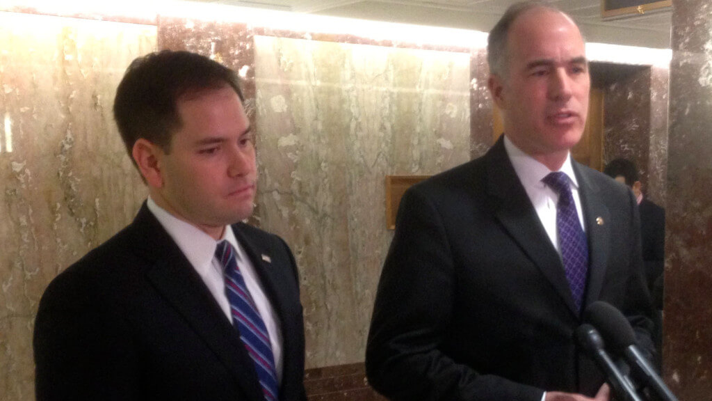 Sen. Marco Rubio, R-Fla., (left) and Sen. Bob Casey Jr., D-Pa., (right) announce Tuesday a new bill to provide nonlethal aid and training to vetted elements of the Syrian opposition. They spoke to reporters in the Dirksen Senate Office Building shortly before a subcommittee hearing on the humanitarian crisis in the region.  (Photo by Marshall Cohen/Medill)